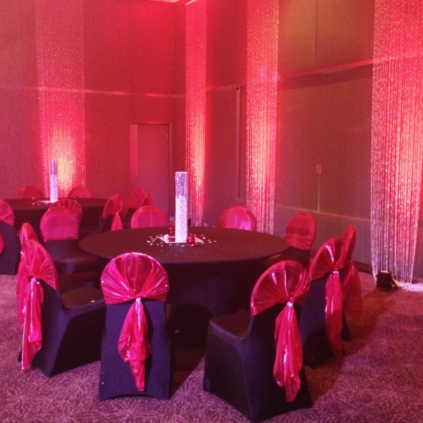 Table Black Chair Cover Red Sash Crystal Curtain Red Uplighting