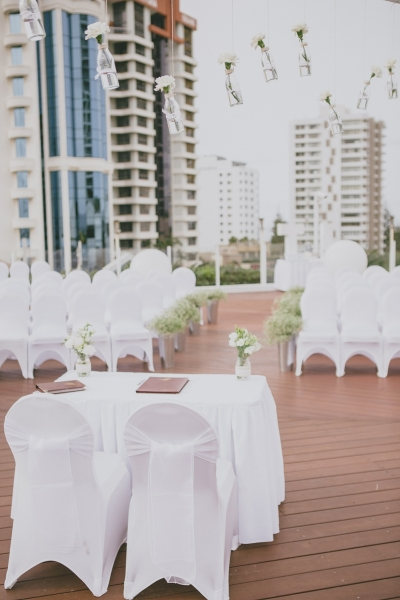 Wedding ceremony on the pool deck, vases with flowers