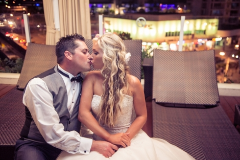 Sofitel-Gold-Coast-Broadbeach-Wedding-Bride-Groom-Kissing-Pool-Deck