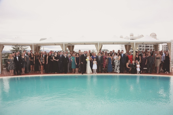 Wedding Ceremony Pool Deck Group Shot Wedding Guests