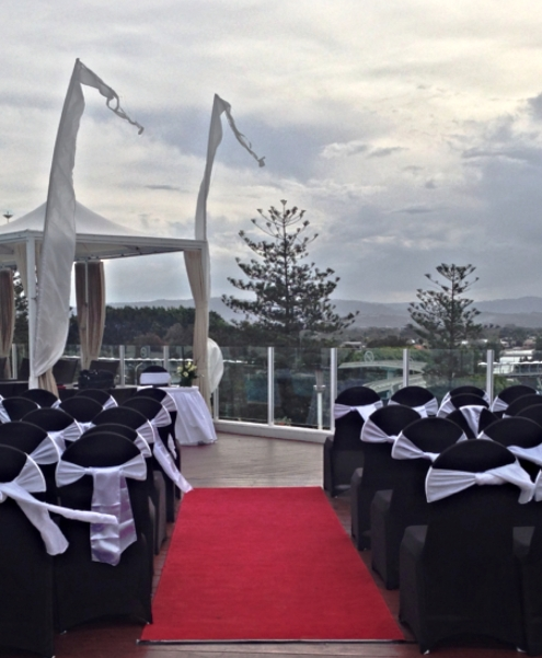 Pool Deck Wedding Ceremony with Black and White Theme
